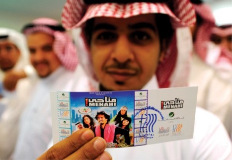 Showing off a ticket to the first Saudi cinema show since decades
