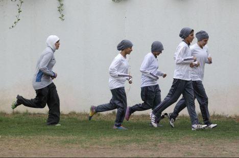 Saudi women's soccer team practising at a secret location in Riyad