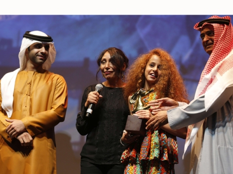 "Saudi director Haifaa Al-Mansour (2nd from left) and young Saudi actress Waad Mohamed (2nd from right) are presented by Sheikh Mansour (left), son of Dubai ruler Sheikh Mohammed Bin Rashid Al-Maktoum, with the award of Muhr Arab Feature award (Best Film) for her film ""Wadjda"" in Dubai on Dec. 16"